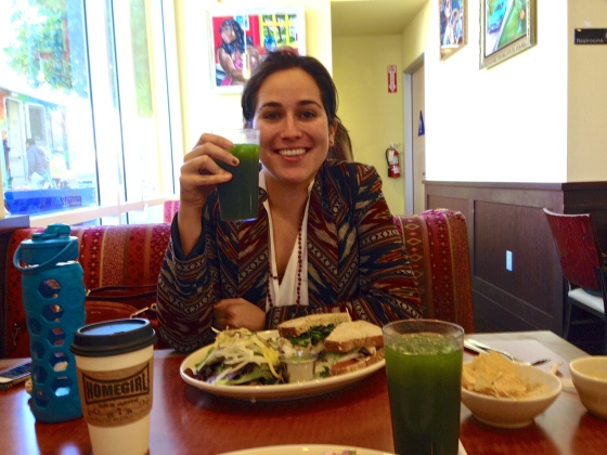 Katherine Katcher, Executive Director of Root & Rebound, eating a delicious Mexican-inspired sandwich and green juice at Homegirl Cafe & Catering.