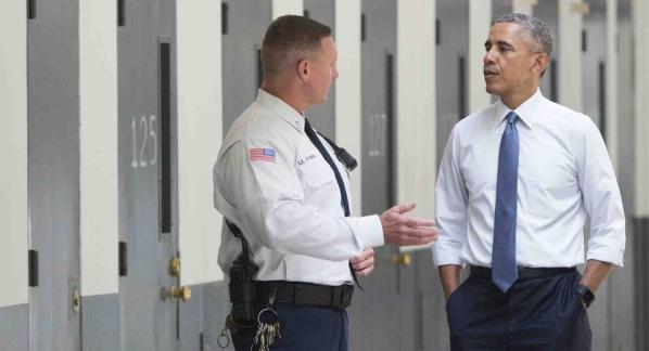US President Barack Obama, alongside Ronald Warlick (L), a correctional officer, tours a cell block at the El Reno Federal Correctional Institution in El Reno, Oklahoma, July 16, 2015. Obama is the first sitting US President to visit a federal prison, in a push to reform one of the most expensive and crowded prison systems in the world. AFP PHOTO / SAUL LOEB (Photo credit: SAUL LOEB/AFP/Getty Images)
